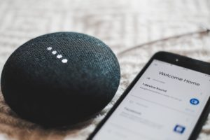 A Google Home Mini being paired with an iphone