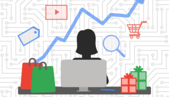Person using desktop surrounded by presents with a line graph and ppc icons in the background